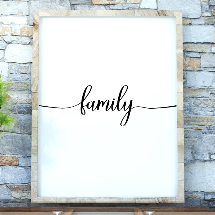 Free printable family wall decor, mockup in frame on wall. Download on tortagialla.com